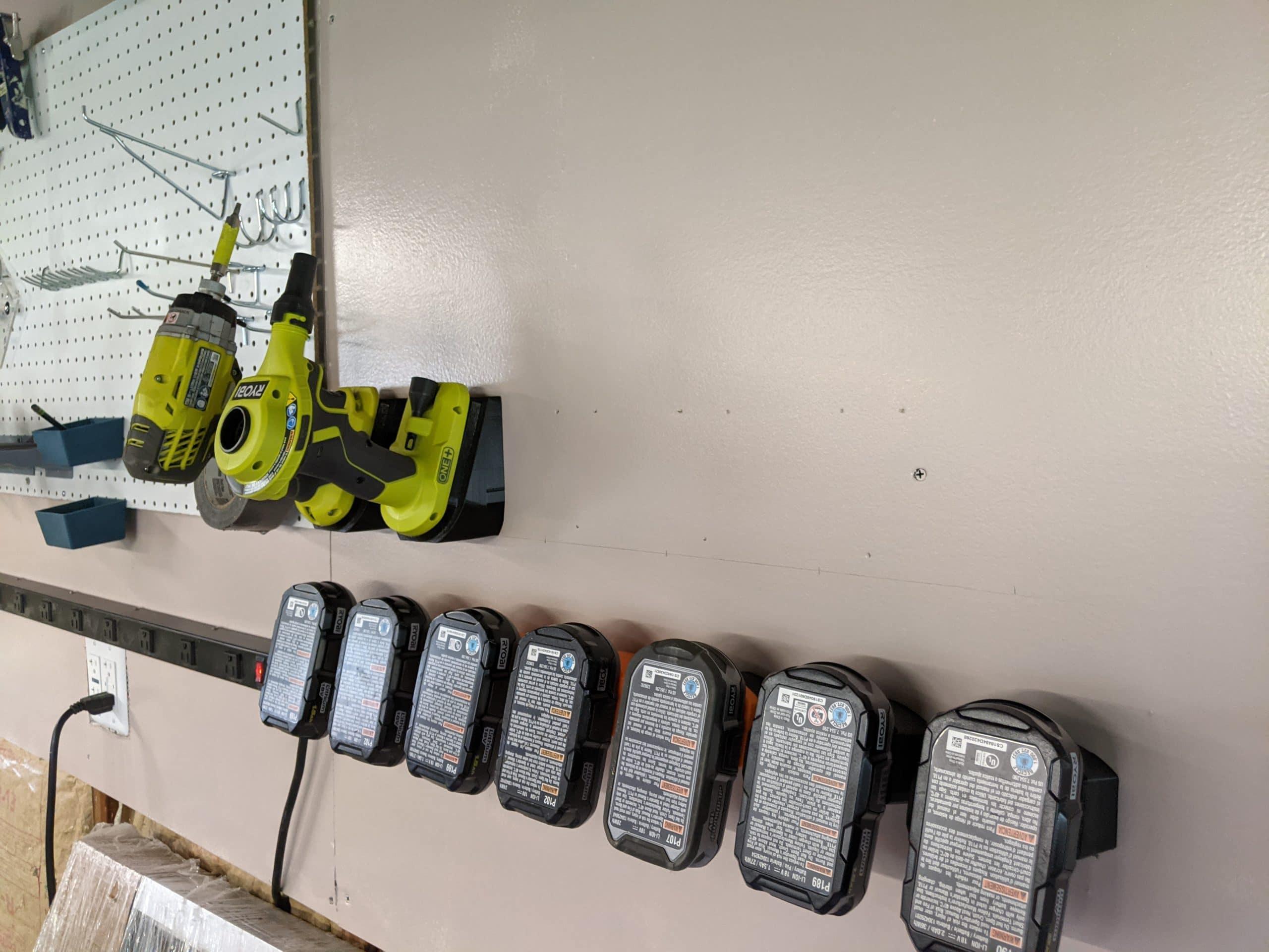 Ryobi batteries and tools mounted on wall